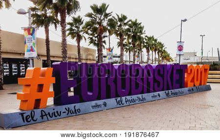 Tel Aviv Israel - Circa November 2016: Advertising of the basketball tournament Eurobasket 2017 on the embankment of the city. It is held from August 31 to September 17 in Finland Israel Romania and Turkey