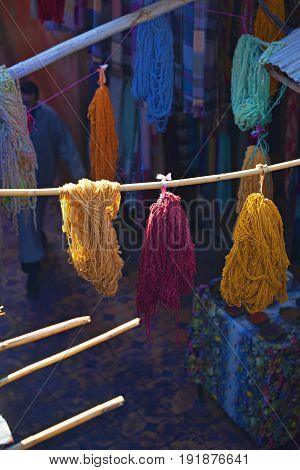 Bundles of dyed wool drying in the souks of Marrakech