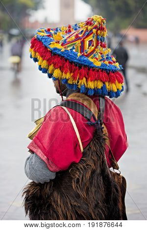 Colourful water bearer in Morocco, main square Marrakech