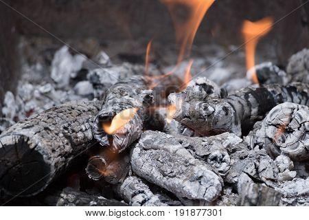 burning coals for shish kebab in the grill