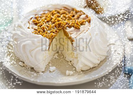 Christmas toffee Pavlova with whipped cream caramel shavings