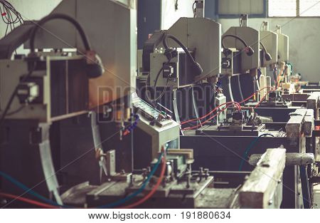 Industrial machines in the factory at metal works side view.