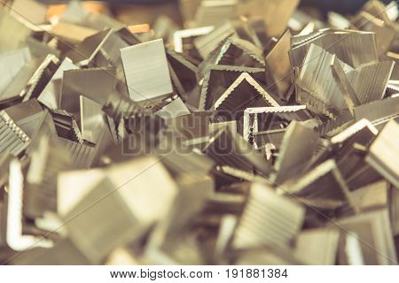 large amounts of scrap metal in industrial foundrycloseup.