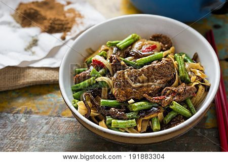 Wok fried beef & mushroom noodles with spices