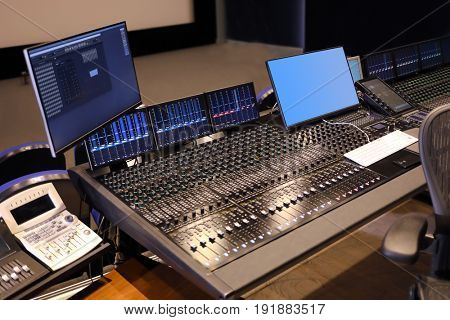 Modern recording studio with special equipment - many equalizers and displays