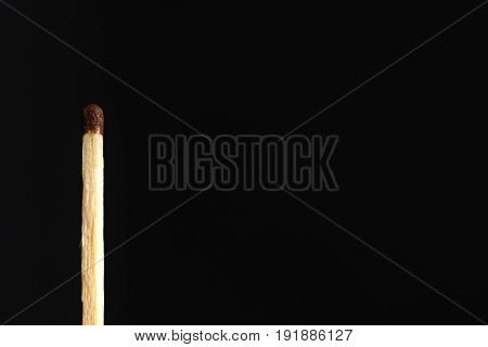 Ordinary Match With A Brown Head Isolated On Black Background