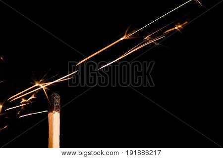 The Burnt Match Over Which Flying Sparks Isolated On Black Background
