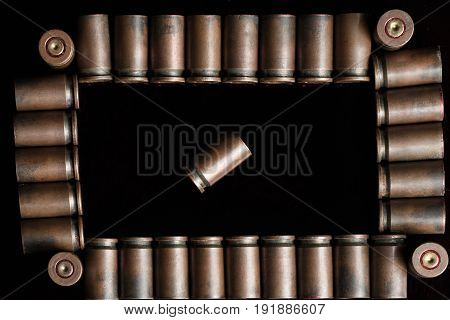 Frame Of Shot Gun Cartridges With One Lying Diagonally In The Center