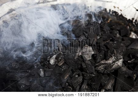 white smoke of wood carbon charcoal burned