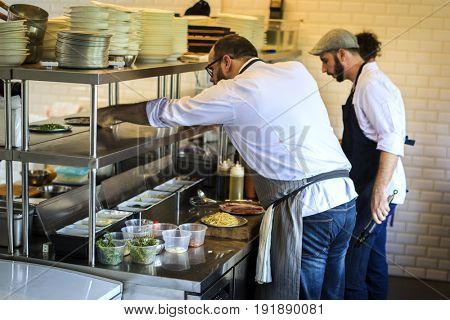 Chef push a food tray to a shelf