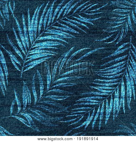 Vector denim exotic palm leaf seamless pattern. Faded jeans background with tropical plants. Blue jeans cloth background.
