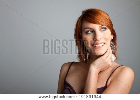 Studioshot of young beautiful woman with red hair.