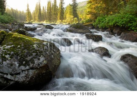 Sunrise And Mountain Flowing Stream