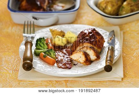 Honey bacon chicken with potatoes and vegetables
