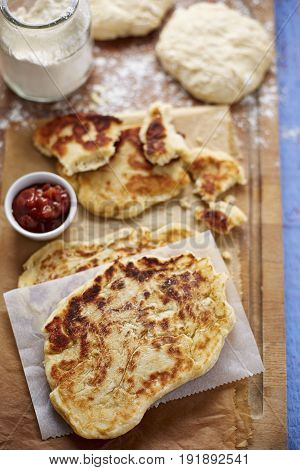 Homemade naan bread with sweet tomato relish