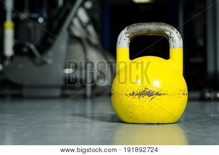 Old kettle bell on the gym floor. Kettle bell workout.