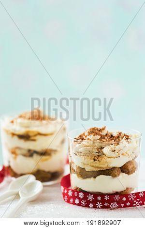 Mini tiramisu pots with biscuits and coffee