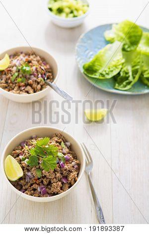Thai pork larb lettuce wraps with lime