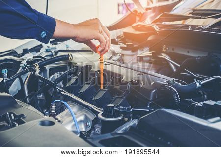 Mechanic Changing Oil Mechanic In Auto Repair Service.