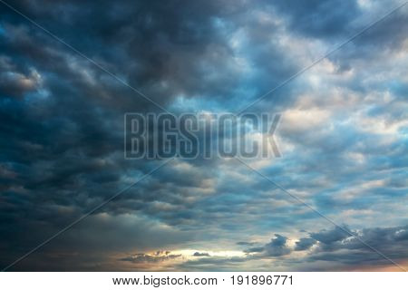 beautiful landscape with sky and dark storm clouds. moody sky. clouds at sunrise sunset. view of heaven morning evening