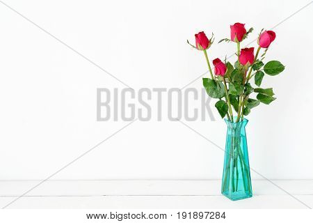 Red roses flower bouquet in green vase on white background romance love symbol valentine's day concept with copy space for text
