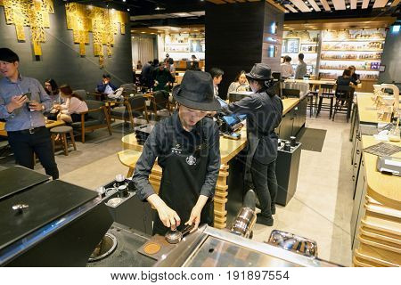 SEOUL, SOUTH KOREA - CIRCA MAY, 2017: worker at Starbucks Reserve. Starbucks Corporation is an American coffee company and coffeehouse chain.