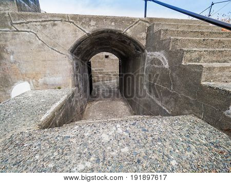 Old military fort passage wall with riffle slits