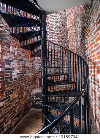 Spiral staircase inside of an old lighthouse