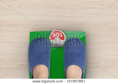 foot standing on weight scales with text