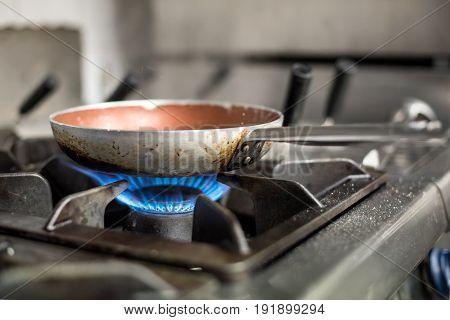 Heating Frying Pan On Burners