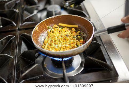 Cooking Tagliatelle Pasta On Burners
