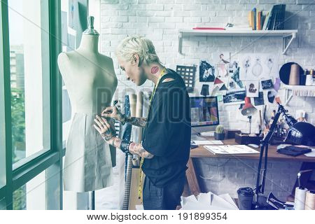 Fashion designer measuring size for tailor made