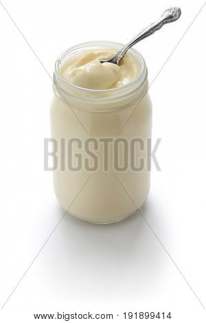 scoop up mayonnaise with a spoon isolated on white background