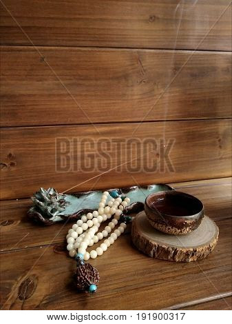 a cup of tee with accessories and censer