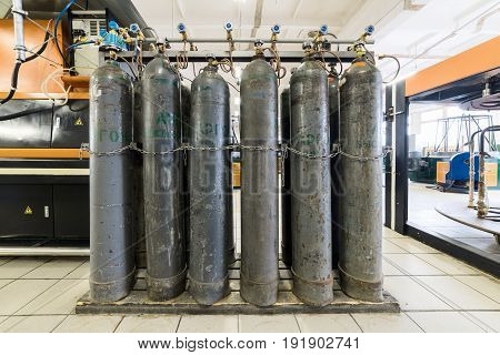Rows of gray gas cylinders. Installation for supplying argon gas to industrial equipment.