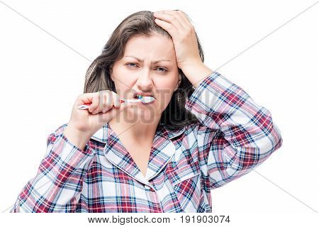Sleepy Dissatisfied Woman Brushing Her Teeth After Waking, Isolated Portrait