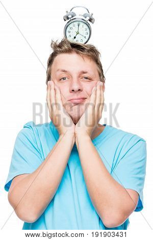 Funny Vertical Portrait Of A Man With An Alarm Clock On His Head On A White Background