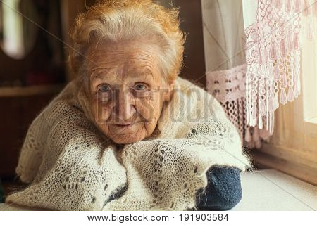 An elderly woman with red and gray hair.