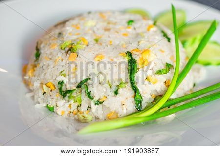 Rice With Vegetables In A Thai Restaurant Close-up On A White Plate