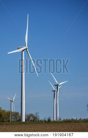 Image of windmill in nice rural landscape