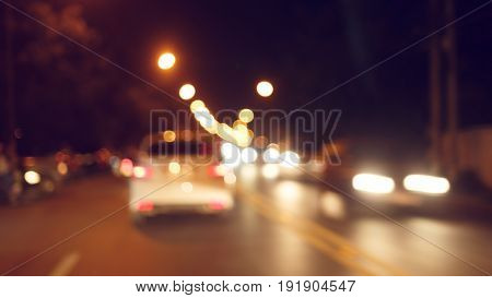 night light of traffic car on the city street abstract blur bokeh background