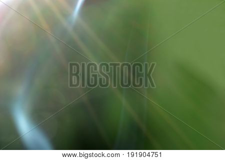 Green background with smoke and backlit. Horizontal image.