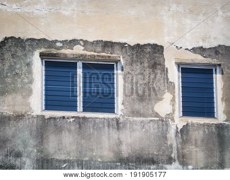 Blue windows on the old cement wall. Bangkok, Thailand