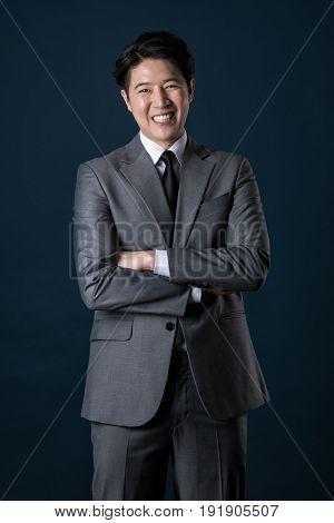 Portrait of a happy Asian business man