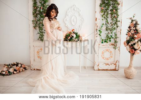 beautiful cute pregnant woman expecting a baby
