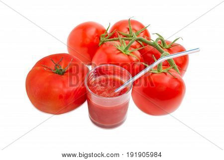 One tomato branch of the fresh ripe tomatoes and tomato juice in glass with bendable drinking straw on a light background