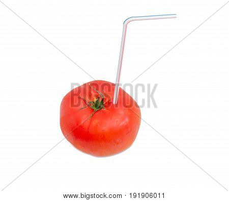 Big fresh ripe tomato and bendable drinking straw inserted into it on a light background