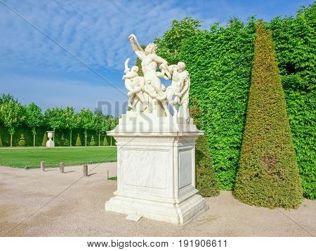 """Marble replica of the famous sculpture """"Laocoon and His Sons"""" on the King's alley in the Gardens of Versailles France poster"""