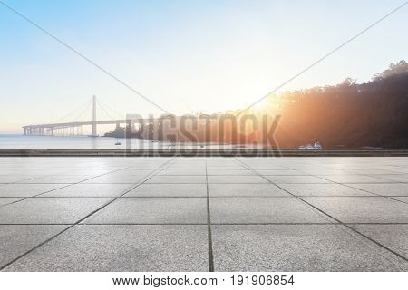 empty floor near golden gate bridge at sunrise