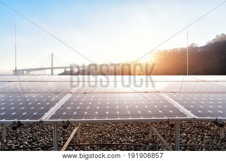 solar panels near golden gate bridge at sunrise